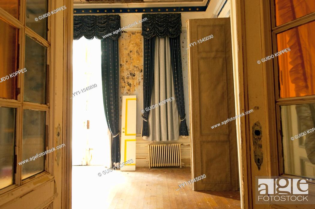 Stock Photo: Huy, Luik / Liege, Belgium. Room and salon in the former Hotel Rouge, abandoned after filing for bankruptcy.