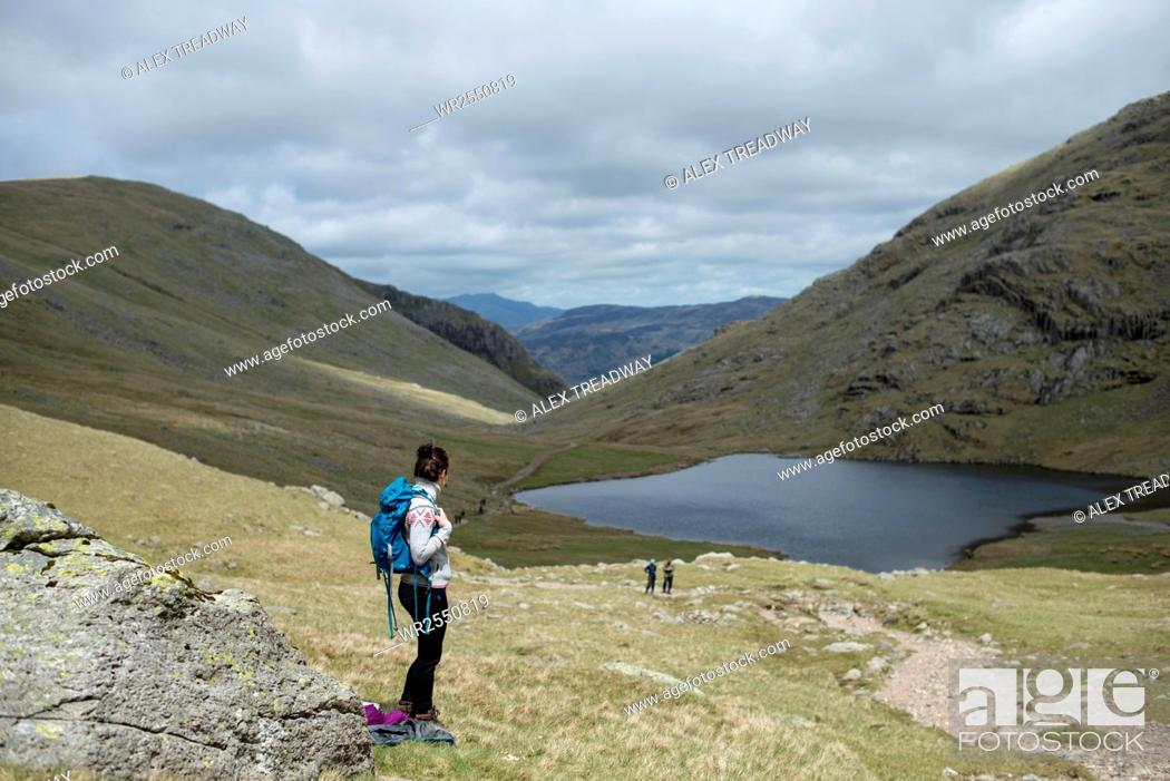 Stock Photo: Looking towards Styhead Tarn on the trail towards Great Gable and Scafell Pike in The Lake District National Park, Cumbria, England, United Kingdom, Europe.