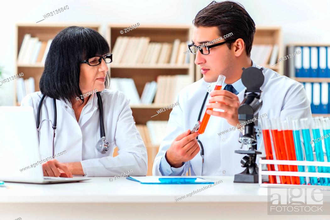 Stock Photo: Two doctors working in the lab.