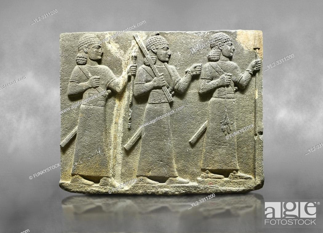 Stock Photo: Hittite relief sculpted orthostat stone panel of Royal Buttress Basalt, Karkamıs, (Kargamıs), Carchemish (Karkemish), 900-700 B. C. Warriors.