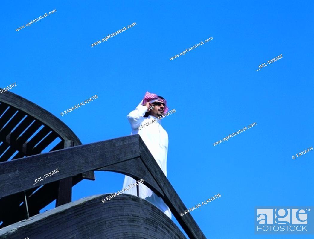 Stock Photo: Saudi businessman using mobile phone in Jeddah, Saudi Arabia.