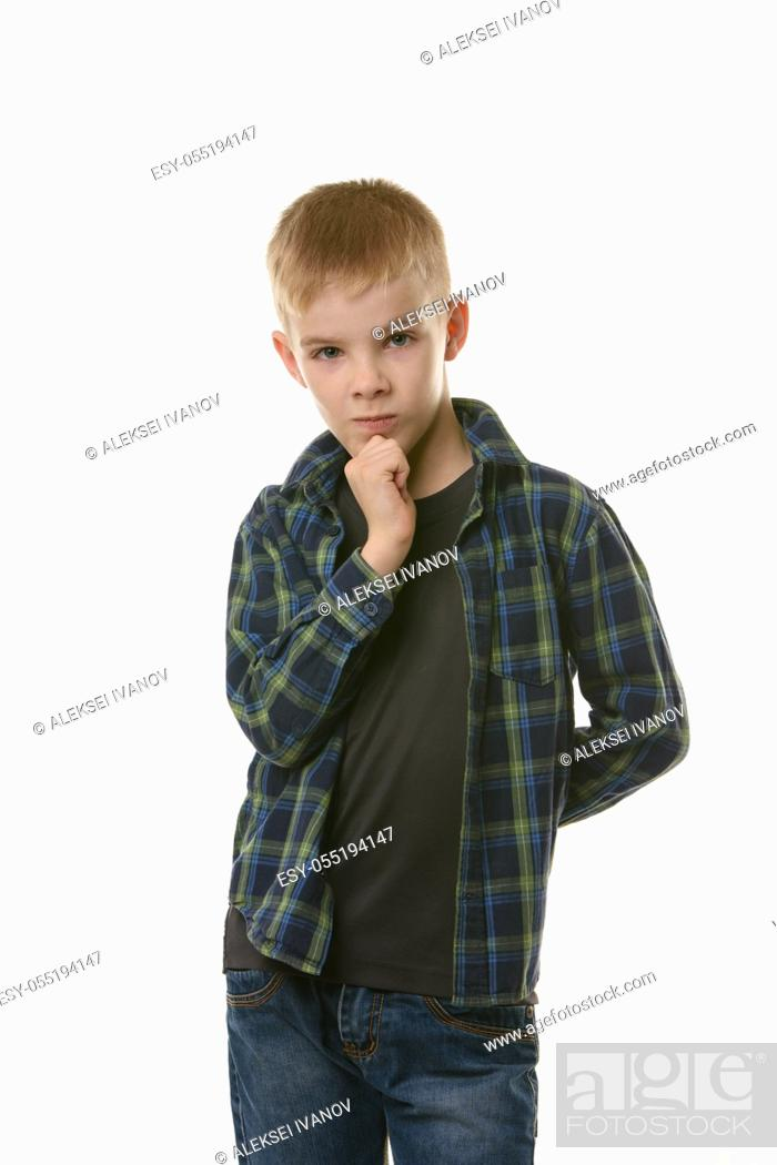 Stock Photo: Portrait of a pensive boy in a plaid shirt on a white background.