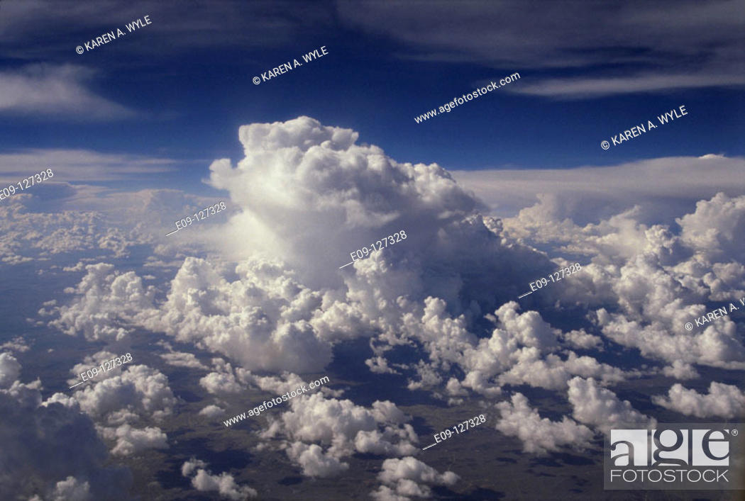 Stock Photo: Majestic cloud formations seen from jet airplane.