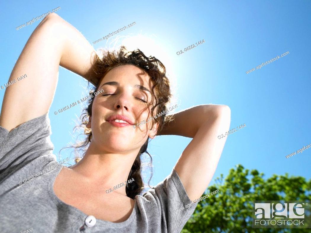 Stock Photo: Woman enjoying the sun.
