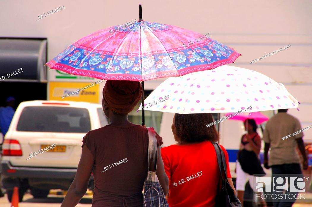 Stock Photo: Women with parasol at Maun, Botswana.