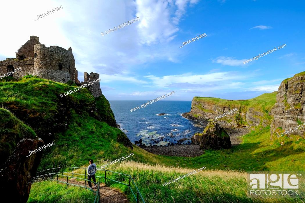 Stock Photo: Dunluce Castle, located on the edge of a basalt outcrop in County Antrim, Ulster, Northern Ireland, United Kingdom, Europe.