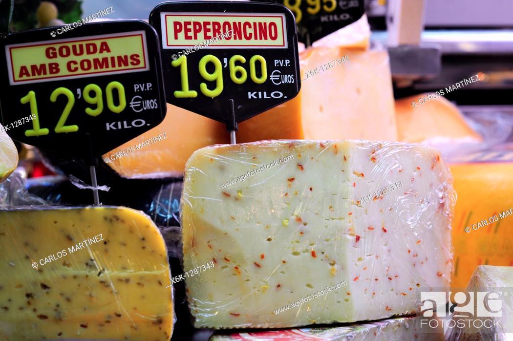 Stock Photo: Assorted cheeses. La Boqueria market, Barcelona, Catalonia, Spain.