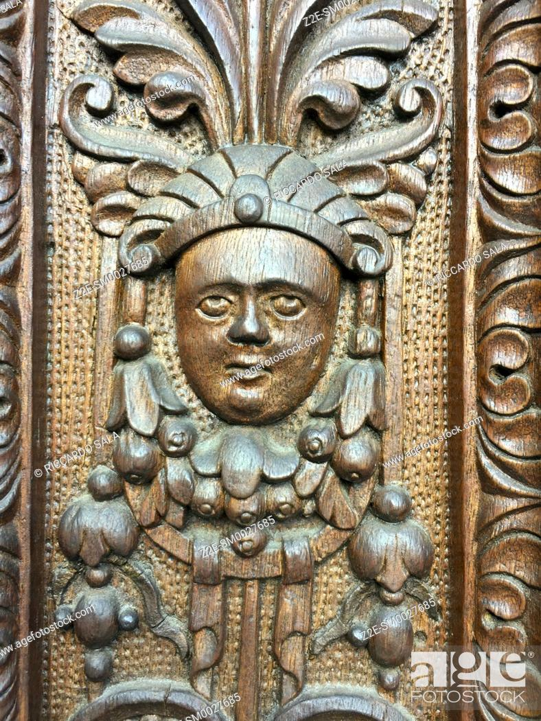 Stock Photo: Italy, Lombardy, Valtellina, Tirano, Sanctuary of the Madonna di Tirano, Detail of the Carved Wooden Door. .