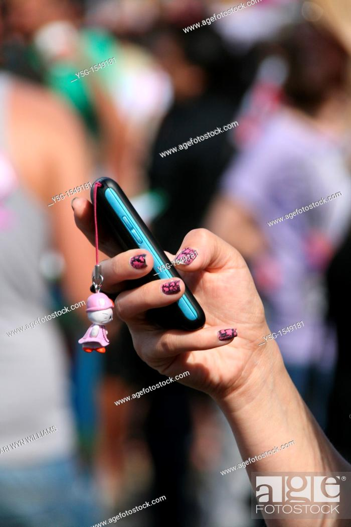 Stock Photo: young woman using mobile cell phone in city town.