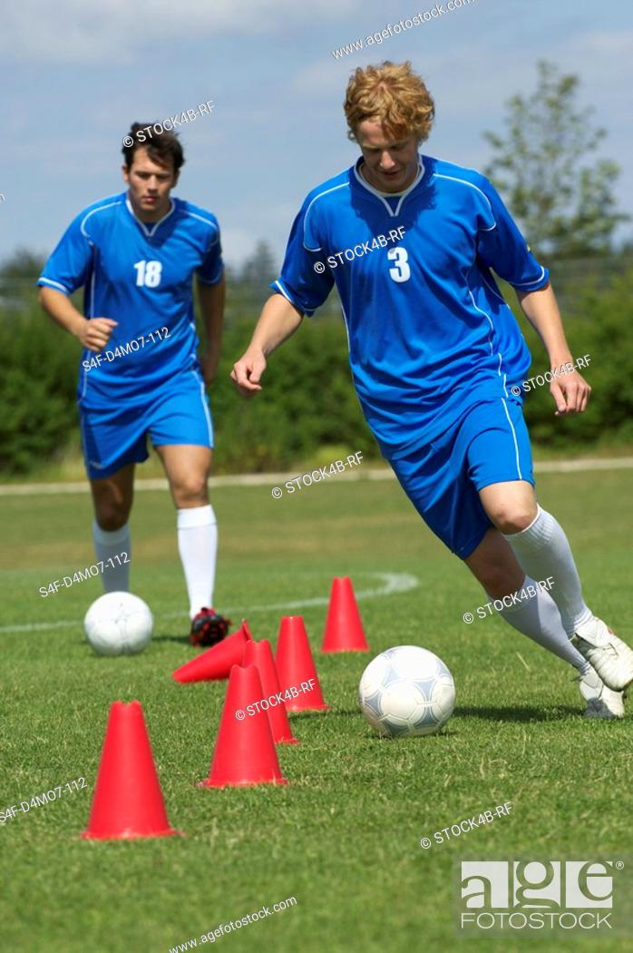 Stock Photo: Kickers exercising.