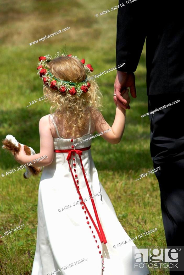 Stock Photo: Girl holding father's hand.