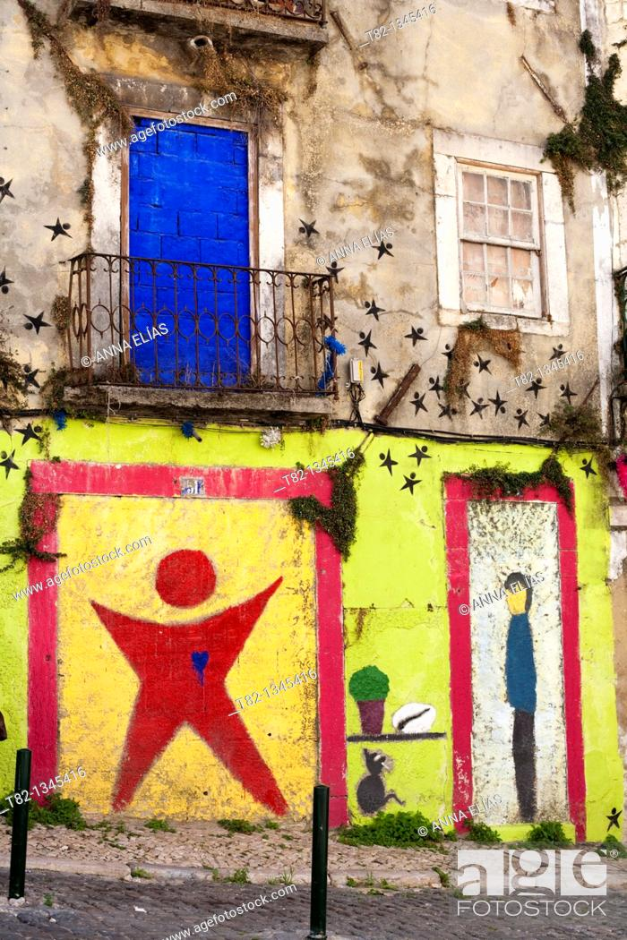 Stock Photo: ruined house facade painted in colors, Lisbon, Portugal, Europe.