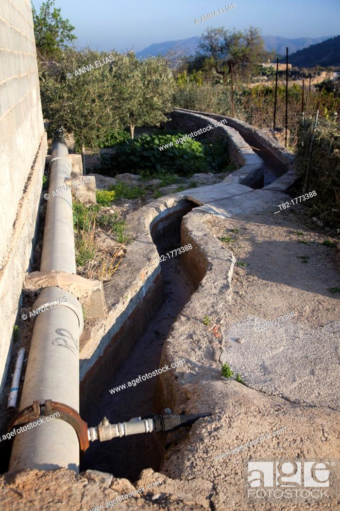Stock Photo: landscape irrigation canal and pipe in orchard, Alhama de Almeria, Andalucia, Spain, Europe.