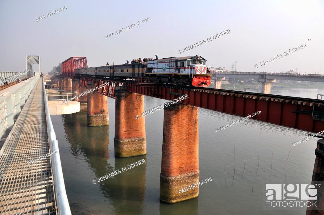 Stock Photo: Old and new railway bridge with train in Ghorashal near Narsingdi on 09.01.2015 - Bangladesh | usage worldwide. - Ghorashal/Dhaka/Bangladesh.