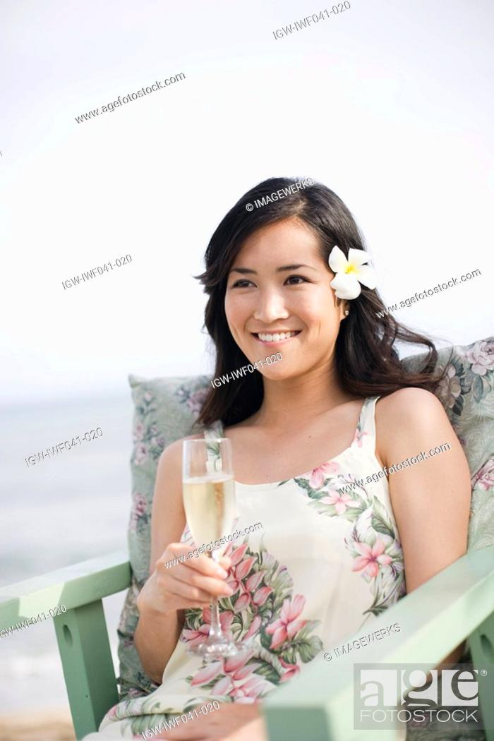 Stock Photo: A woman holding wineglass.
