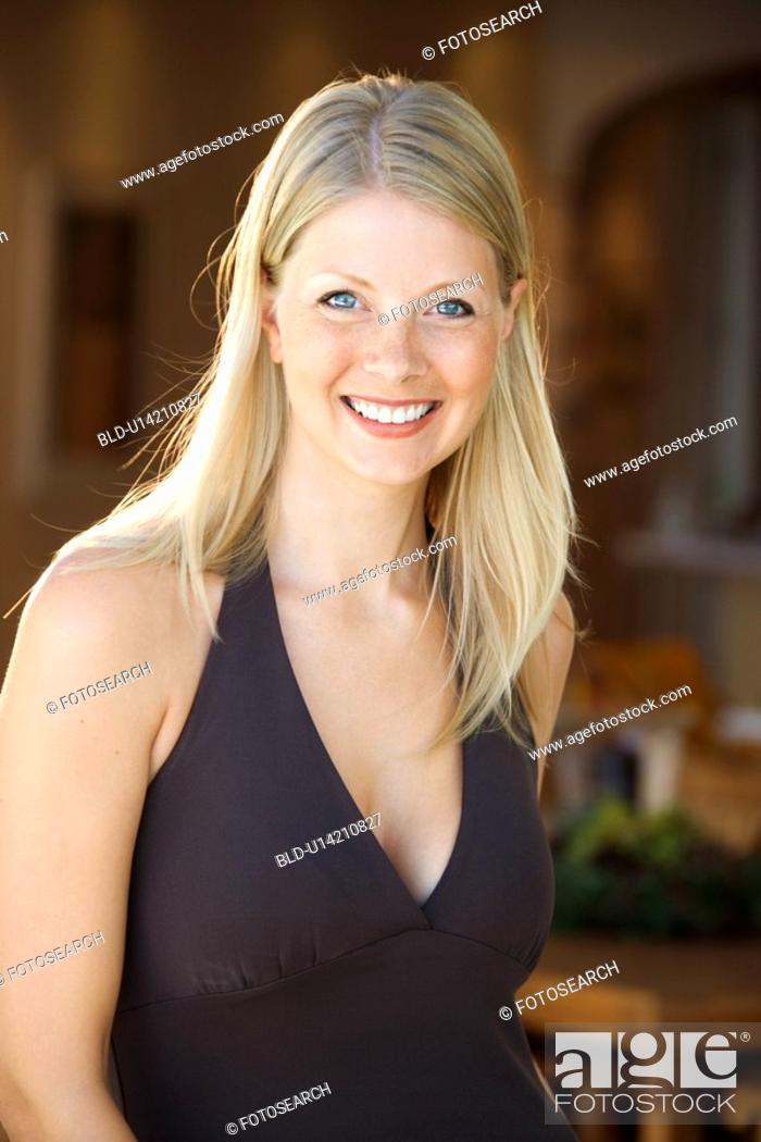 Stock Photo: Caucasian mid adult woman smiling at viewer.
