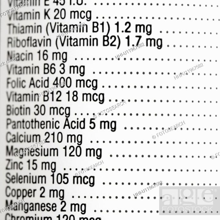 Stock Photo: Close up of supplement label with amount of vitamins.