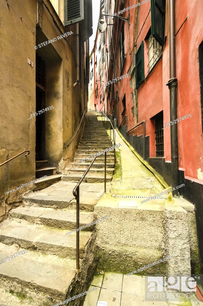 Stock Photo: Narrow street in the old area of Genoa, Italy.