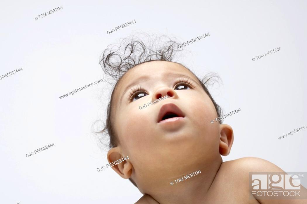 Stock Photo: A baby boy looking up.