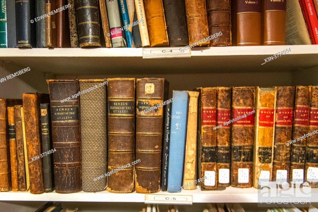 Stock Photo: Old books in library at Little Falls Friends Meeting - Quaker meeting house in Harford County Maryland.