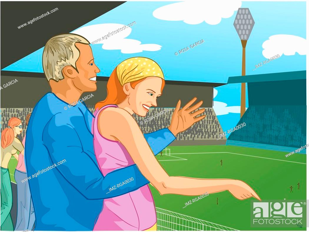 Stock Photo: couple at a soccer game.