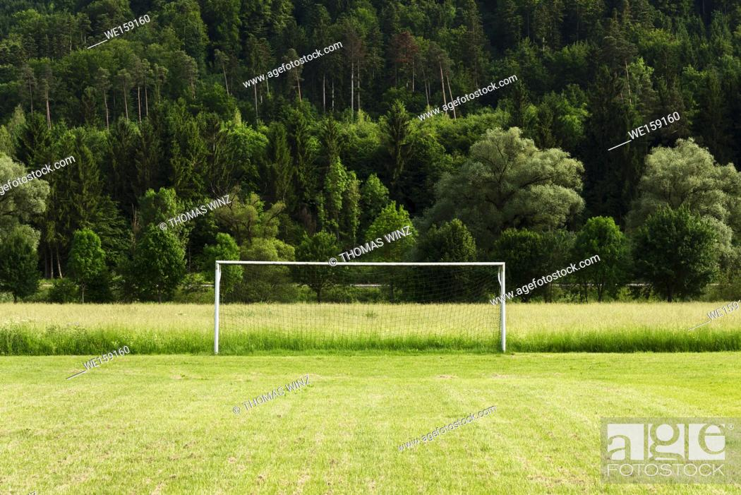 Stock Photo: Soccer field with soccer goal in the countryside , Springtime , lush forest, Baden Württemberg , Germany.