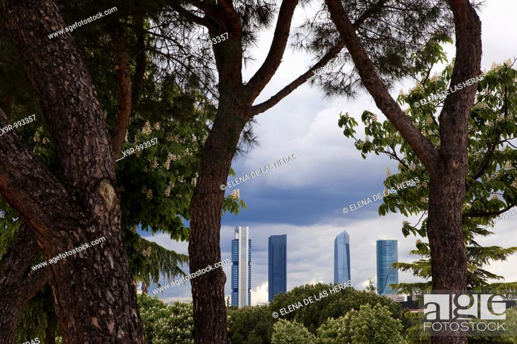 Stock Photo: Four towers business area CTBA seen through the trees. Madrid. Spain.