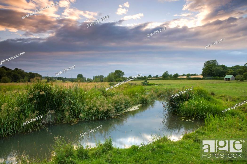 Stock Photo: The River Windrush meanders through water meadows just outside the Cotswolds town of Burford, Oxfordshire, England, United Kingdom, Europe.