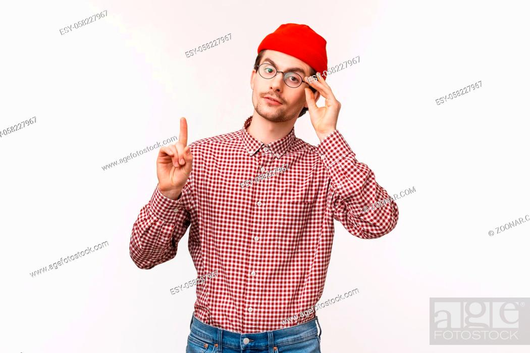 Stock Photo: Waist-up portrait of smart and snobbish man patronising someone, scolding someone or correct person, raise one finger adding his opinion, fixing glasses on face.