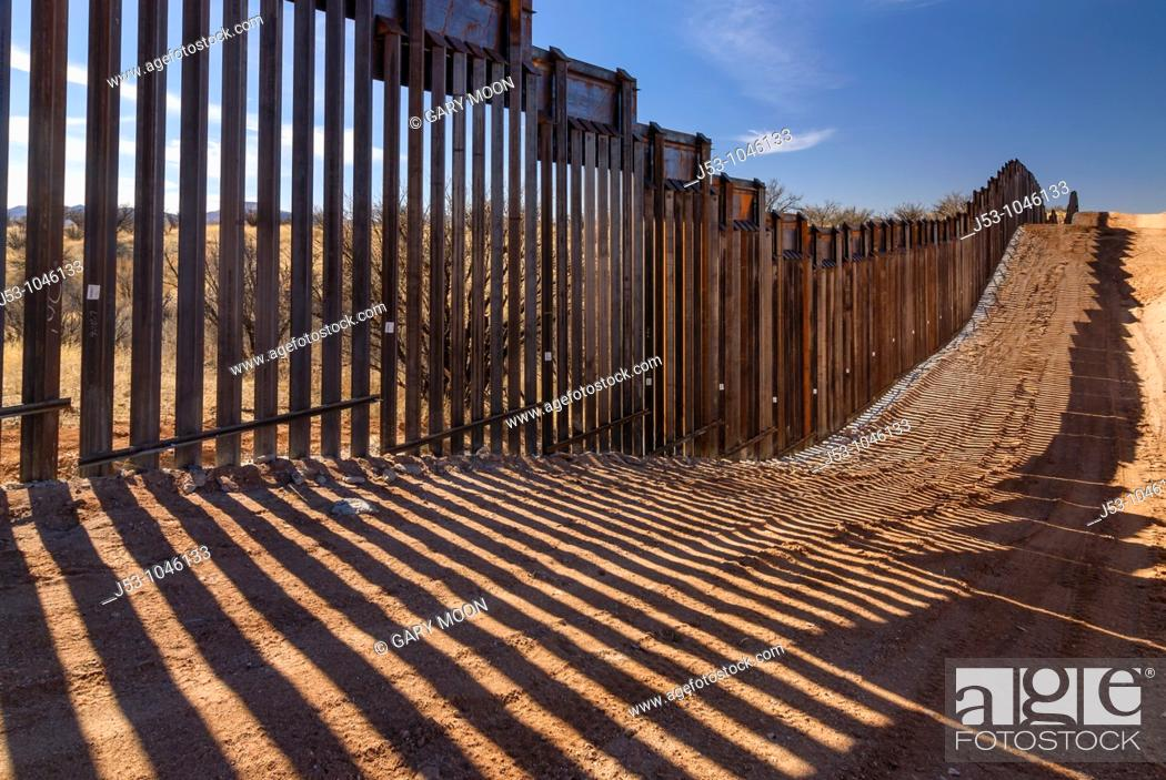 Stock Photo: United States border fence, US/Mexico border, east of Nogales, Arizona, USA, viewed from US side.