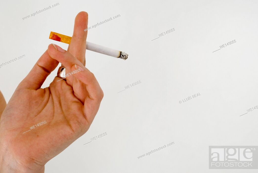 Stock Photo: woman hand holding a cigarette.