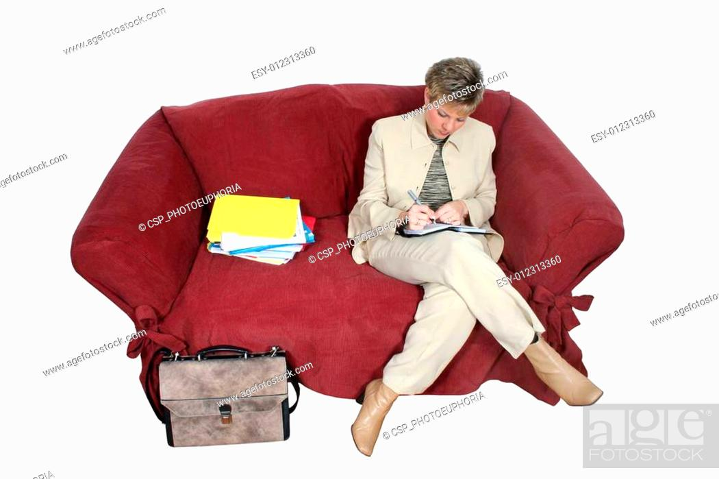 Stock Photo: Business Woman Working at Home on Couch.