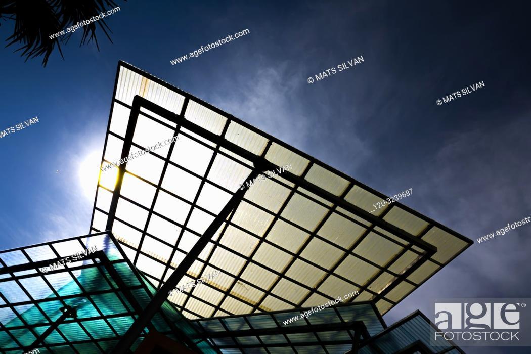 Imagen: Modern Glass Roof with Sunlight in Switzerland.