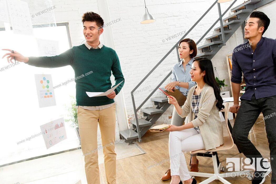 Imagen: Business men and women work in the studio.