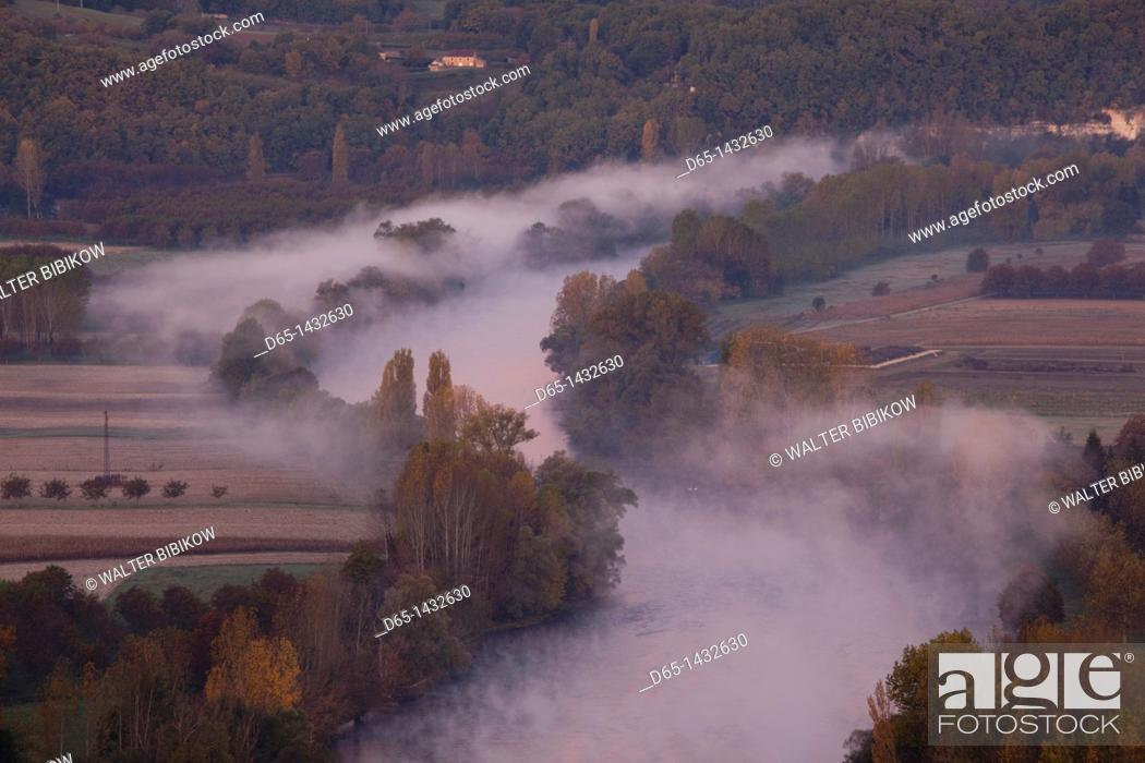 Stock Photo: France, Aquitaine Region, Dordogne Department, Domme, elevated view of the Dordogne River Valley in fog from the Belvedere de la Barre, dawn.