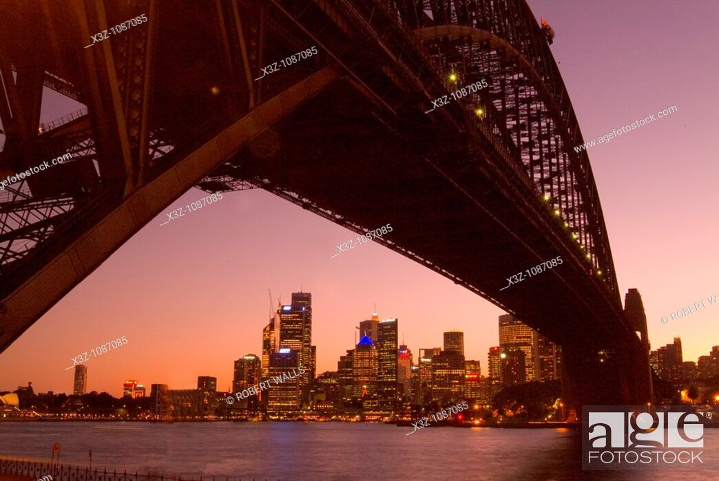 Stock Photo: The Sydney skyline at sunset framed by the Harbour Bridge from North Sydney.