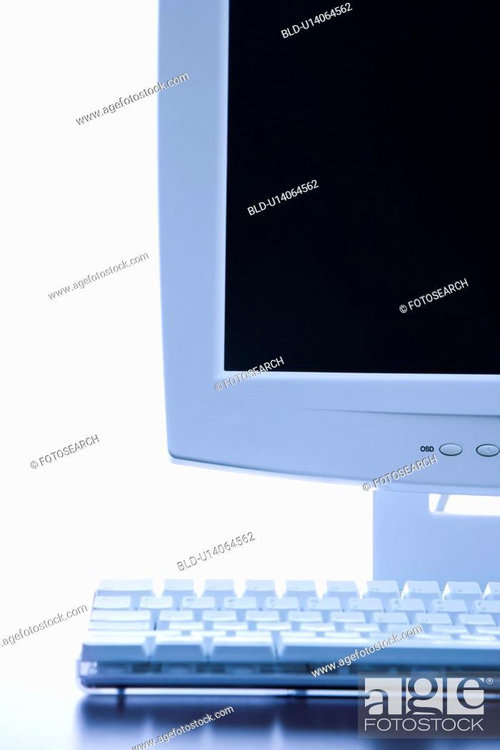 Stock Photo: Computer monitor and keyboard.