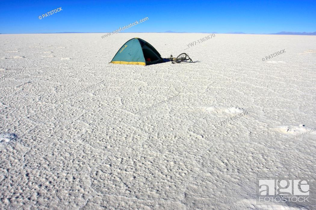 Stock Photo: A tent and a bicycle on the frozen salt lake called 'Salar de Uyuni' in Bolivia.