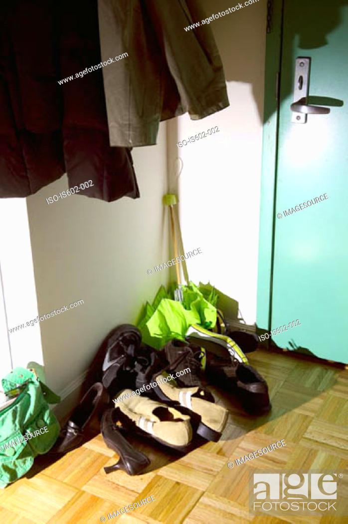 Stock Photo: Shoes in corridor.