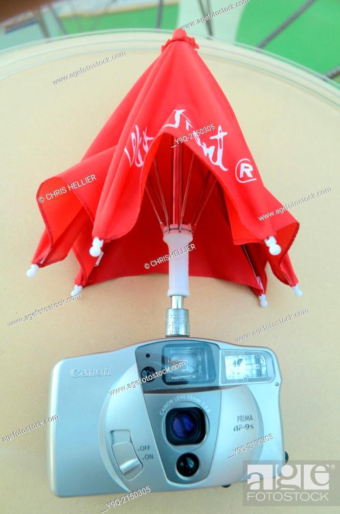 Stock Photo: Umbrella Gadget to Protect Camera.