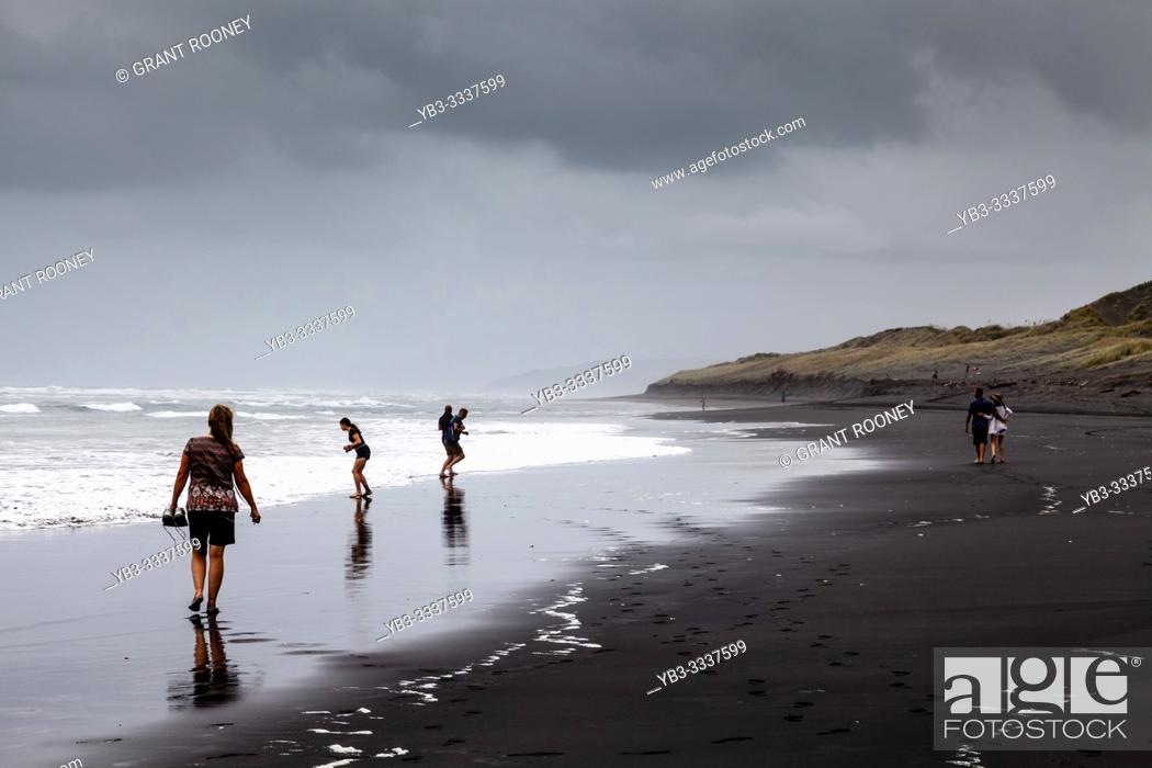 Stock Photo: A Group Of People Walking Along Hot Water Beach (Ocean Beach), Kawhia, North Island, New Zealand.