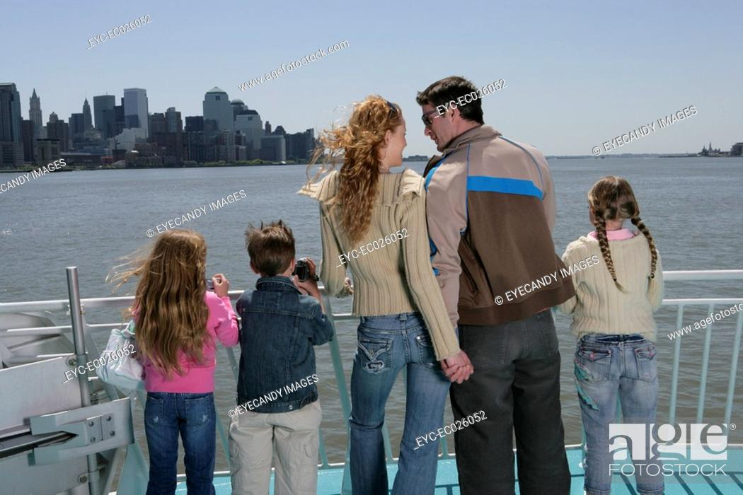 Stock Photo: Family of five on the bow of a ferryboat.