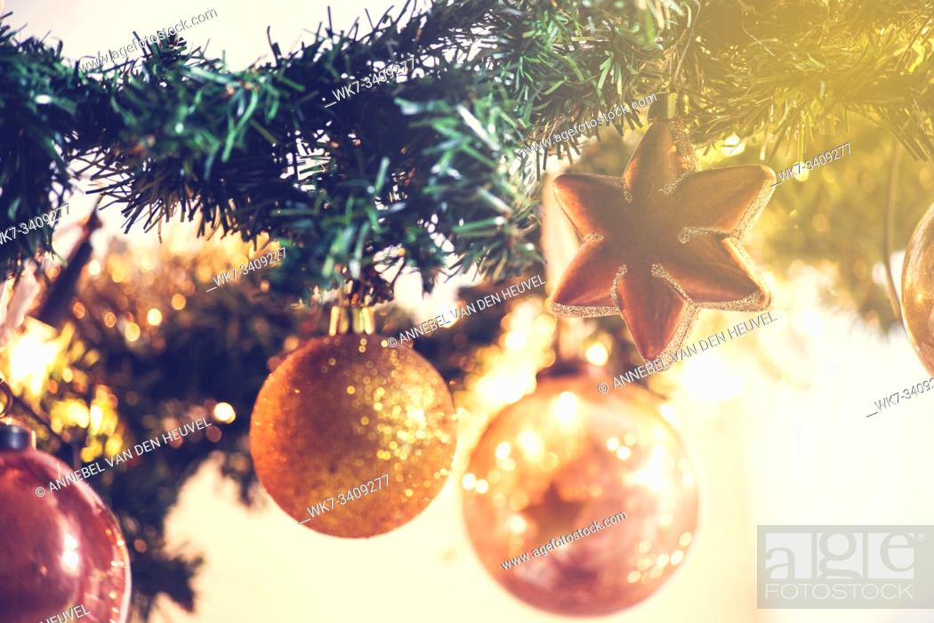 Stock Photo: Gold Christmas balls decoration in tree, beautiful sparkles close-up winter holiday, christmas card.