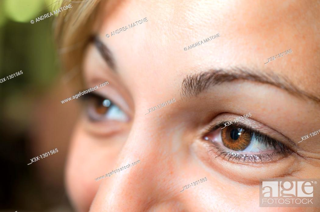 Stock Photo: Woman wearing brown contact lenses.