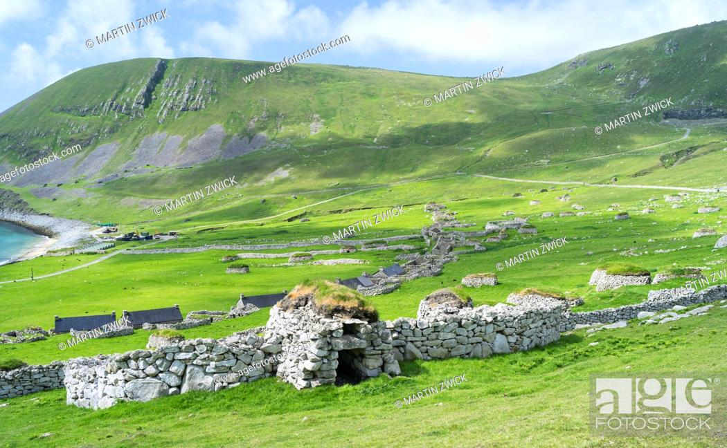 Stock Photo: The islands of St Kilda archipelago in Scotland. Island of Hirta with village bay and the settelment abondoned 1930, Cleit traditional bothy in the foreground.