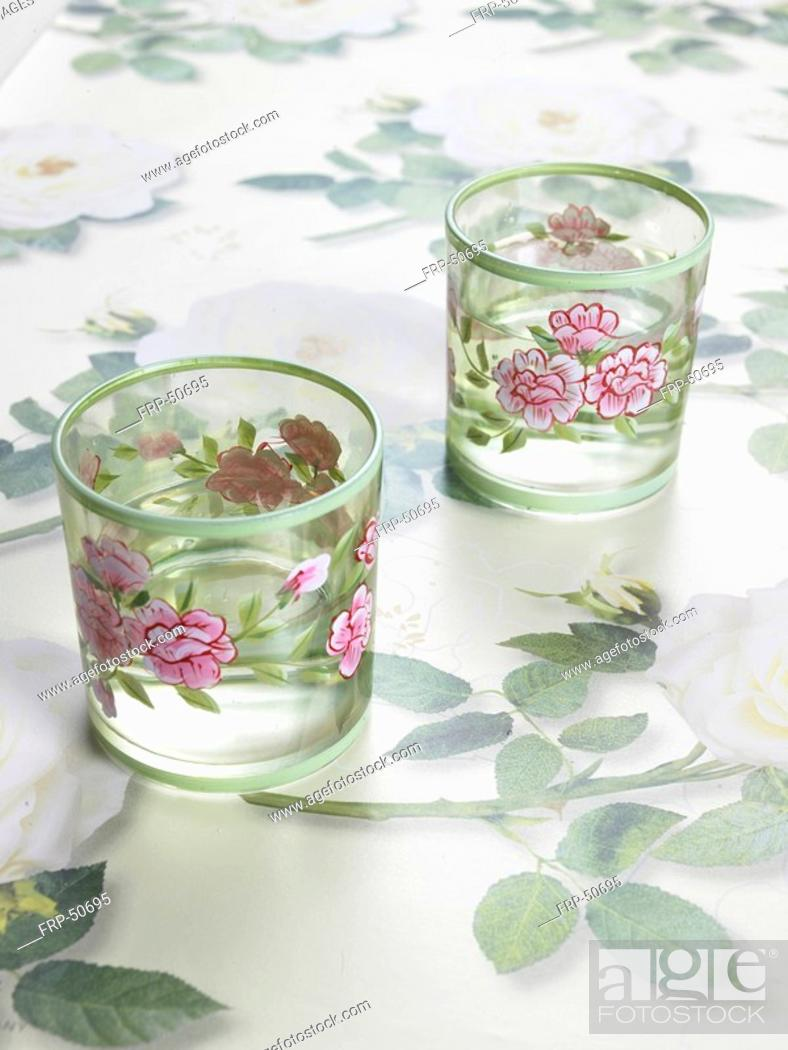 Stock Photo: Two glasses with a flowery pattern.