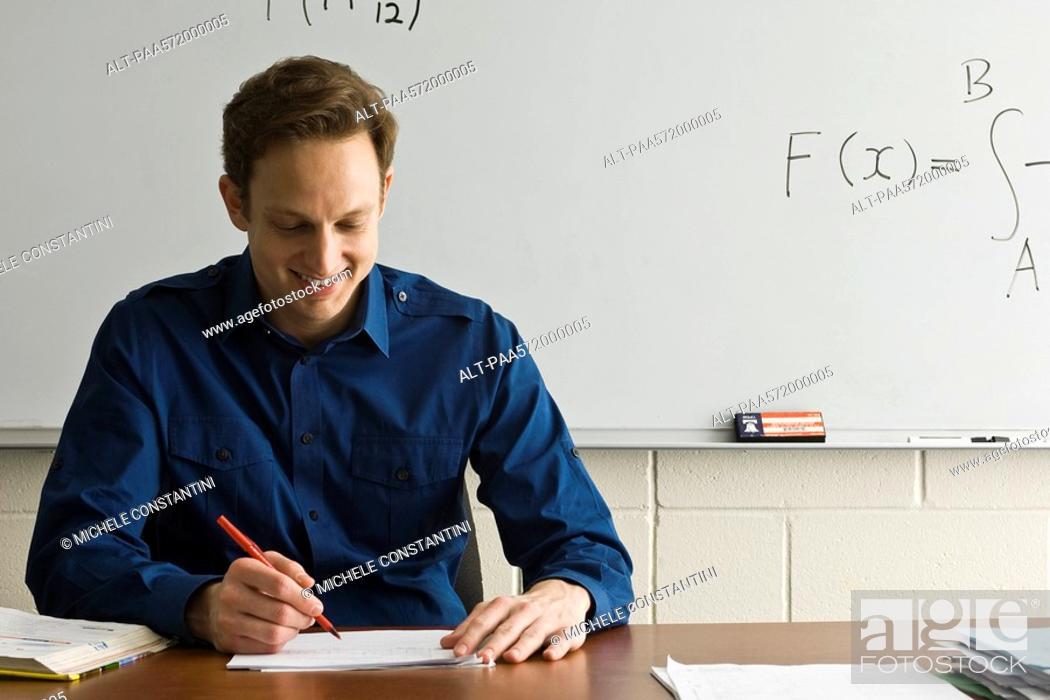 Stock Photo: Teacher marking homework.