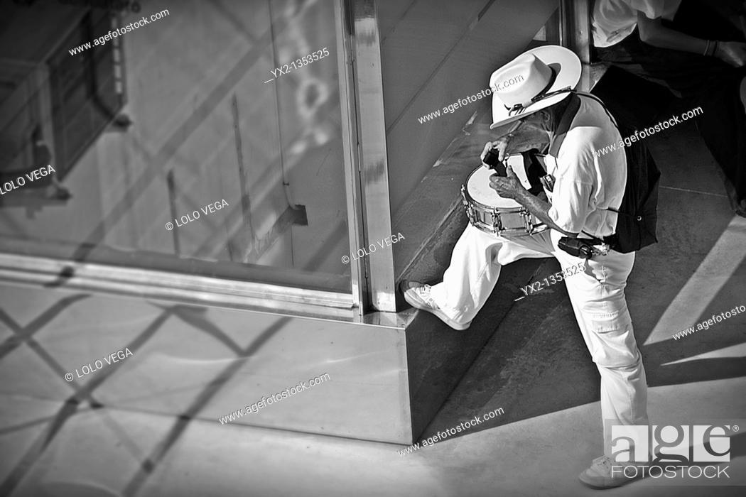 Stock Photo: Man preparing drum.