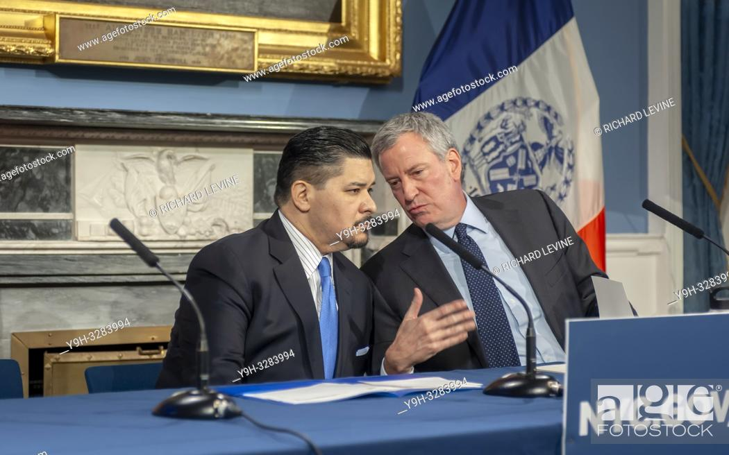 Stock Photo: New York Mayor Bill de Blasio, right, and Richard A. Carranza, Dept. of Education Schools Chancellor at a press conference in the Blue Room in New York City.