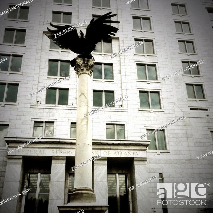 Stock Photo: Eagle on pillar outside the Federal Reserve building in Atlanta, Georgia.